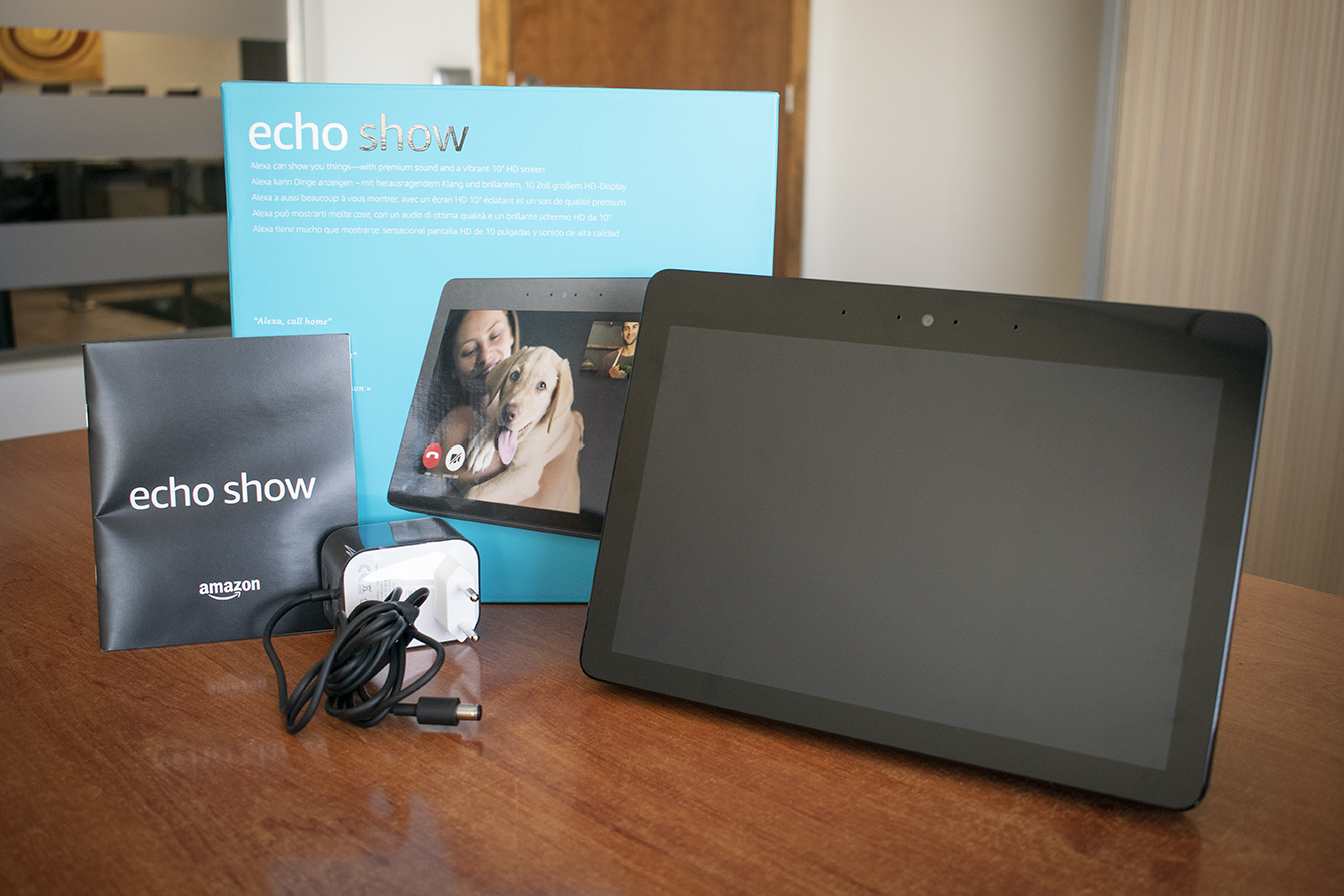 Amazon Echo Show box next to device, charger and quick guide