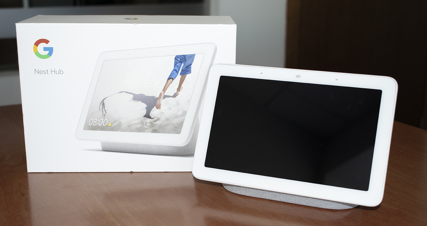 Google Nest Hub facing next to its box